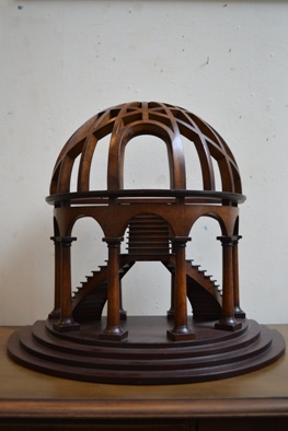<div>Demi-lune shaped Italian Renaissance dome structure, shown in half-section and open structure with an internal staircase</div>