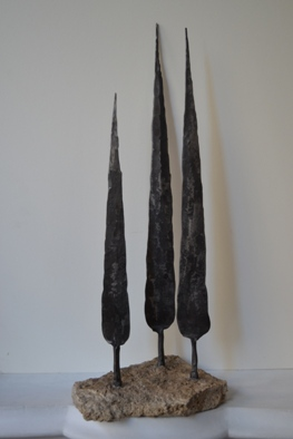 <div>Clump of cypress trees</div>
